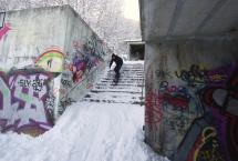 Riding Snowboard Down Stairs